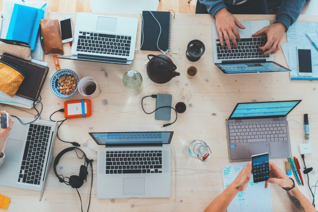 teamwork, laptops, custom software development